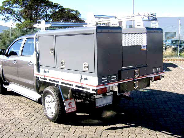 grey lift off service body on ute